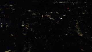 AX141_088 - 6K stock footage aerial video approaching Harvard University, Massachusetts, night