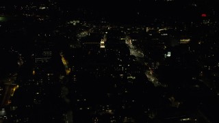 AX141_089 - 6K stock footage aerial video flying by Lowell House, Mt Auburn, Harvard University, Massachusetts, night