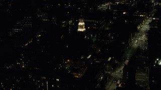 AX141_090 - 6K stock footage aerial video flying by Lowell House, Harvard University, Massachusetts, night
