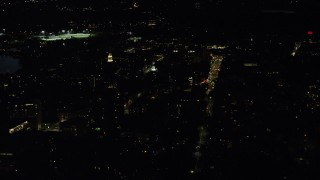 AX141_098 - 6K stock footage aerial video orbiting Lowell House and Adams House, Harvard University, Massachusetts, night