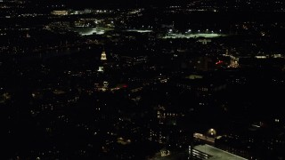 AX141_100 - 6K stock footage aerial video flying by the campus of Harvard University, Massachusetts, night
