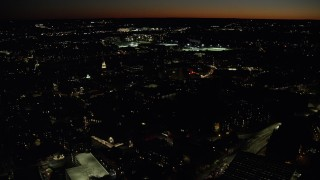 AX141_101 - 6K stock footage aerial video flying by the campus, sports field, Harvard University, Massachusetts, night