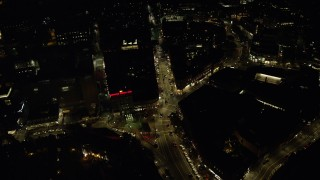 AX141_104 - 6K stock footage aerial video of a bird's eye view over Harvard Square, Massachusetts Avenue, Harvard University, Massachusetts, night