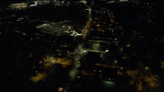 AX141_108 - 6K stock footage aerial video approaching Western Avenue, Allston, Massachusetts, night