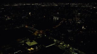 AX141_112 - 6K stock footage aerial video of Anderson Memorial Bridge, John W. Weeks Bridge, Harvard University, Massachusetts, night