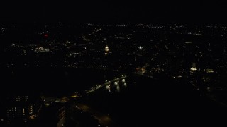 AX141_118 - 6K stock footage aerial video flying by Lowell House, John W. Weeks Bridge, Harvard University, Massachusetts, night