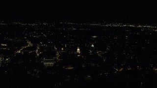 AX141_120 - 6K stock footage aerial video orbiting Lowell House on campus, Harvard University, Massachusetts, night