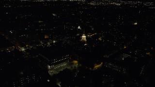 AX141_121 - 6K stock footage aerial video orbiting Lowell House and Adams House, Harvard University, Massachusetts, night