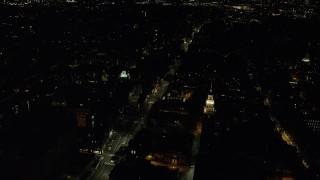 AX141_122 - 6K stock footage aerial video orbiting Lowell House, Adams House, Mt Auburn Street, Harvard University, Massachusetts, night