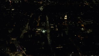 AX141_124 - 6K stock footage aerial video orbiting Adams House and Lowell House, Harvard University, Massachusetts, night