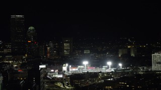 AX141_143 - 6K stock footage aerial video flying by Fenway Park with a baseball game in progress, Boston, Massachusetts, night