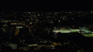 AX141_145 - 6K stock footage aerial video of Massachusetts Institute of Technology, sports fields, Cambridge, Massachusetts, night