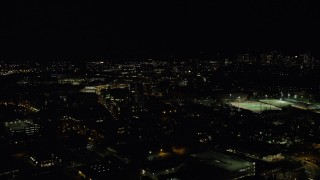 AX141_147 - 6K stock footage aerial video flying by Massachusetts Institute of Technology, office buildings, Cambridge, Massachusetts, night