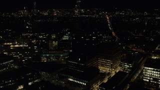 AX141_152 - 6K stock footage aerial video flying by Massachusetts Institute of Technology, Cambridge, Massachusetts, night