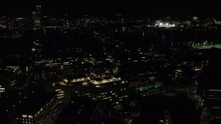AX141_153 - 6K stock footage aerial video flying by MIT, Massachusetts Institute of Technology, Cambridge, Massachusetts, night