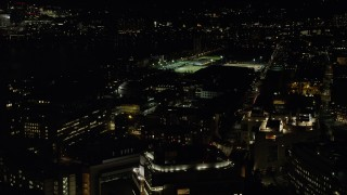 AX141_154 - 6K stock footage aerial video flying by Massachusetts Institute of Technology, Cambridge, Massachusetts, night