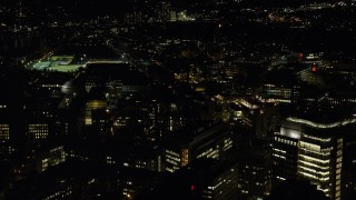 AX141_155 - 6K stock footage aerial video flying by Massachusetts Institute of Technology campus, Cambridge, Massachusetts, night
