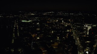 AX141_156 - 6K stock footage aerial video flying by MIT campus, Massachusetts Institute of Technology, Cambridge, Massachusetts, night