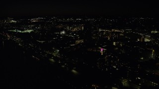 AX141_157 - 6K stock footage aerial video flying by campus buildings, Massachusetts Institute of Technology, Cambridge, Massachusetts, night