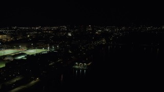 AX141_161 - 6K stock footage aerial video flying by sports fields, Massachusetts Institute of Technology, Cambridge, Massachusetts, night