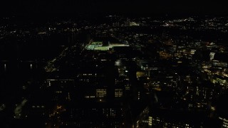 AX141_168 - 6K stock footage aerial video approaching Maclaurin Building, sports fields, Massachusetts Institute of Technology, Cambridge, Massachusetts, night