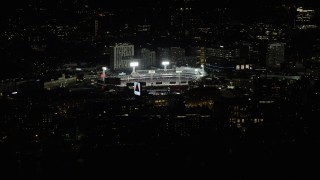 AX141_170 - 6K stock footage aerial video flying by bright lights of baseball game, Fenway Park, Boston, Massachusetts, night