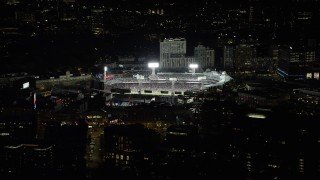 AX141_171 - 6K stock footage aerial video flying by game at Fenway Park, Boston, Massachusetts, night