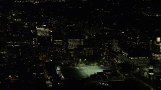 AX141_173 - 6K stock footage aerial video orbiting Beth Israel Hospital, Longwood Medical Area, Boston, Massachusetts, night