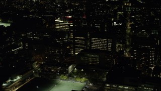 AX141_174 - 6K stock footage aerial video orbiting Longwood Medical Area, Beth Israel Hospital, Boston, Massachusetts, night