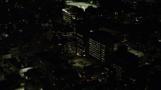AX141_175 - 6K stock footage aerial video orbiting Beth Israel Hospital, Longwood Medical Area, Boston, Massachusetts, night