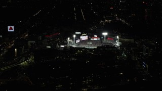 AX141_181 - 6K stock footage aerial video orbiting city streets, baseball game at Fenway Park, Boston, Massachusetts, night