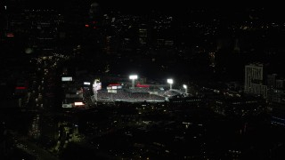 AX141_182 - 6K stock footage aerial video orbiting city streets, Boston Red Sox game, Fenway Park, Boston, Massachusetts, night