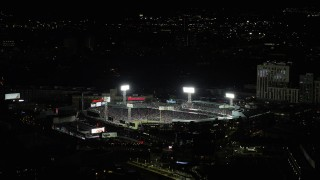 AX141_183 - 6K stock footage aerial video orbiting crowded stadium, Fenway Park, Boston, Massachusetts, night