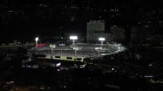 AX141_184 - 6K stock footage aerial video orbiting Boston Red Sox game at Fenway Park, Boston, Massachusetts, night