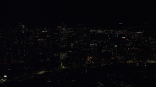 AX141_188 - 6K stock footage aerial video flying by skyscrapers, Downtown Boston, Massachusetts, night