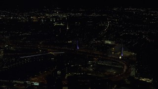 AX141_199 - 6K stock footage aerial video flying by Zakim Bridge, approach Bunker Hill Monument, Charlestown, Massachusetts, night