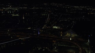 AX141_200 - 6K stock footage aerial video approaching Zakim Bridge, Bunker Hill Monument, Charlestown, Massachusetts, night