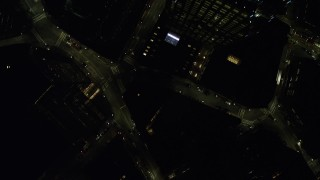 AX141_206 - 6K stock footage aerial video of a bird's eye view over city streets, buildings, Downtown Boston, Massachusetts, night