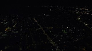 AX141_219 - 6K stock footage aerial video flying by Broadway, Dorchester Heights Monument, South Boston, Massachusetts, night