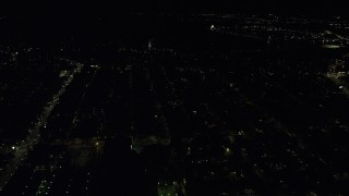 AX141_220 - 6K stock footage aerial video flying by Dorchester Heights Monument, South Boston, Massachusetts, night