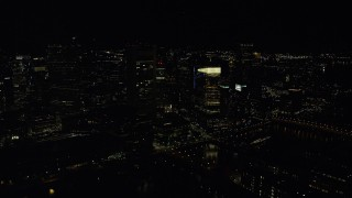 AX141_236 - 6K stock footage aerial video approaching Federal Reserve Bank, Russia Wharf, Downtown Boston, Massachusetts, night