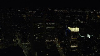 AX141_237 - 6K stock footage aerial video flying over Federal Reserve Bank, Keystone, approach Russia Wharf, Downtown Boston, Massachusetts, night