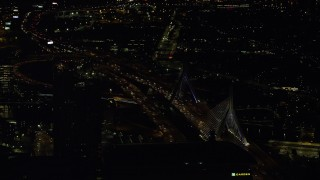 AX141_241 - 6K stock footage aerial video flying by the Zakim Bridge, Boston, Massachusetts, night