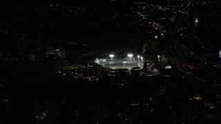 AX141_243 - 6K stock footage aerial video flying by baseball game in progress, Fenway Park, Boston, Massachusetts, night