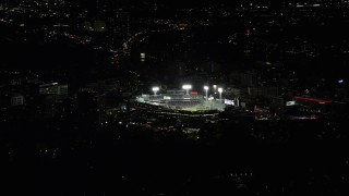 AX141_244 - 6K stock footage aerial video flying by bright lights of baseball game, Fenway Park, Boston, Massachusetts, night