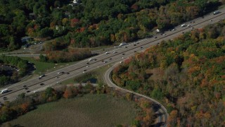 AX142_006 - 6K stock footage aerial video flying over Interstate 93, homes, trees, autumn, Westwood, Massachusetts