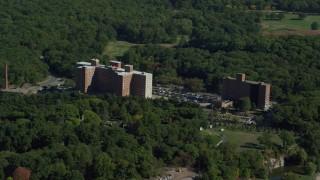 AX142_013 - 6K stock footage aerial video approaching Lemuel Shattuck Hospital, autumn, Jamaica Plain, Massachusetts