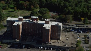 AX142_014 - 6K stock footage aerial video approaching, orbiting Lemuel Shattuck Hospital, autumn, Jamaica Plain, Massachusetts