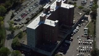AX142_015 - 6K stock footage aerial video flying away from Lemuel Shattuck Hospital, autumn, Jamaica Plain, Massachusetts