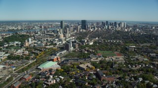 AX142_017 - 6K stock footage aerial video flying over Roxbury, approaching skyline, autumn, Downtown Boston, Massachusetts